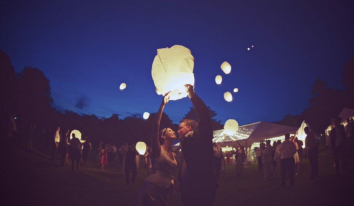 western_michigan_vintage_outdoor_tent_wedding_lantern_release_52